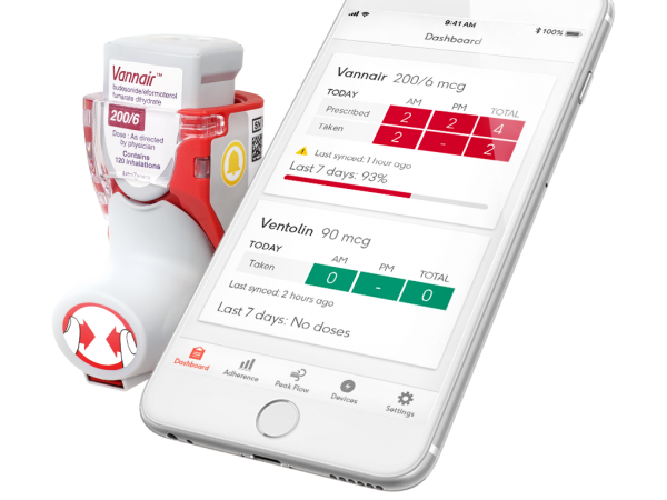 A Smart inhaler next to a white smartphone showing the app in use